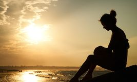 Profile of a sad young woman silhouette in swimsuit Royalty Free Stock Images