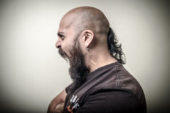 Profile screaming angry bearded man Stock Images