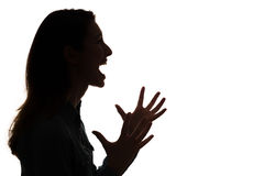 Profile of screaming woman in silhouette royalty free stock images