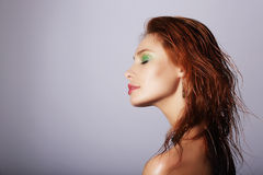 Profile of Seductive Redhead Woman with Wet Hair Royalty Free Stock Photography
