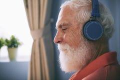 Senior music lover stock image
