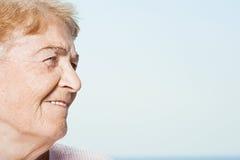 Profile of a senior woman stock image
