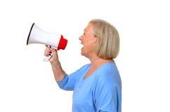 Profile of a senior woman using a megaphone Royalty Free Stock Photo
