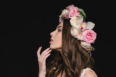 Profile of sensual woman with curly hair in flower wreath Royalty Free Stock Image