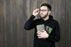 In the profile of a serious young man  in glasses and in black c. In the profile of a serious young man with a small beard in glasses and in black clothes with Stock Photos