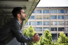 Profile  shot of attractive bearded young man in city Royalty Free Stock Image