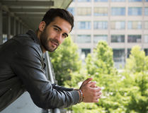 Profile  shot of attractive bearded young man in city Royalty Free Stock Images