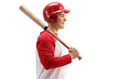 Profile shot of baseball player with helmet and bat Stock Photos