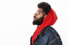 Profile shot of cool and stylish confident and self-satisfied african american male rap-singer wearing hoodie and denim stock photography