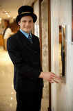 Profile shot of a doorman in bowler hat Royalty Free Stock Image