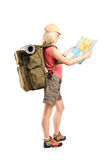 Profile shot of a female tourist looking at a map Stock Image