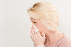 Profile Shot of Lady Pressing Tissue on Nose Copy Space Royalty Free Stock Images