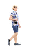 Profile shot of a male tourist walking. Isolated on white background Stock Photo