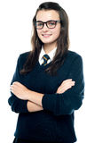 Profile shot of pretty bespectacled teenager. Posing with crossed arms Stock Image
