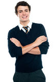 Profile shot of a school going teenager. Profile shot of a school going teen in uniform posing with arms crossed Royalty Free Stock Photos