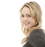 Profile shot of a smiling blonde woman. Wearing a grey top on a white background Stock Photos