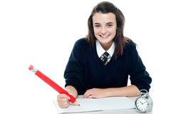 Profile shot of smiling school girl Royalty Free Stock Photography