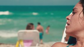 Profile shot of woman enjoying a drink in front of beautiful ocean stock video