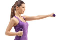Profile shot of a woman exercising with dumbbells Stock Images