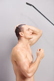 Profile shot of a young man taking a shower Stock Photo