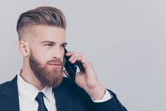 Profile side half-faced view portrait of serious intelligent clever handsome with mustache executive financier banker manager. Boss speaking on phone with head stock photography