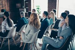 Profile side view of crowd nice trendy specialists experts sharks attending educative classes courses lecture corporate. Conference at industrial loft style stock photos