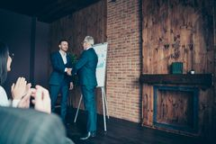 Profile side view of nice stylish elegant sharks marketers ceo boss chief shaking hands welcome to new start-up finance royalty free stock image