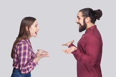 Profile side view portrait of funny surprised bearded man and woman in casual style standing and looking at each other with amaze stock photos
