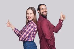 Profile side view portrait of happy satisfied bearded man and woman in casual style standing and looking at camera, smiling with stock photography