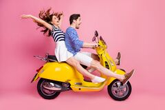 Profile side view portrait of his he her she nice attractive lovely crazy couple riding moped spending weekend journey