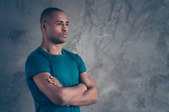 Profile side view portrait of his he nice-looking attractive strong powerful content dreamy guy wearing trendy blue t. Shirt folded arms isolated over gray royalty free stock photography