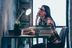 Profile side view portrait of nice attractive charming brunette lady in checked shirt exhausted of hard difficult work stock image