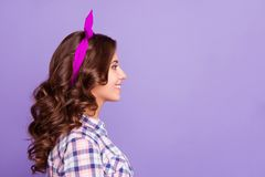 Profile side view portrait of nice minded calm sweet lovely wins. Ome attractive adorable wavy-haired lady copy empty blank space isolated over violet pastel stock images