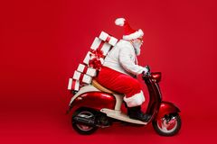 Free Profile Side View Portrait Of Nice Bearded Funny Funky Purposeful Santa Claus Riding Moped Hurry Up Delivering Pile Stock Photos - 161053383