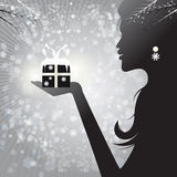 Profile silhouette of a woman holding a gift Royalty Free Stock Photo