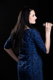Profile of singer girl in blue dress Stock Images