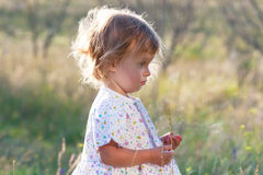 Profile small girl in the light dress Royalty Free Stock Photos
