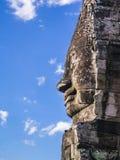 Profile of smiling stone Buddha face at Bayon temple,  Cambodia. Profile of smiling stone Buddha face at Bayon temple, Angkor Thom, Siem Reap, Cambodia Royalty Free Stock Images