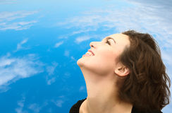 Profile of smiling woman and the sky Royalty Free Stock Photo