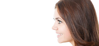 Profile of smiling young female isolated Stock Image