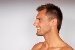 Profile of smiling young man. Royalty Free Stock Image