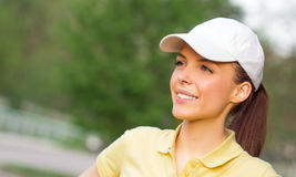 Profile of a smiling young sports woman Royalty Free Stock Image