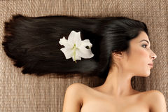 Profile spa portrait woman lilly flower in her Royalty Free Stock Photos