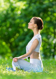 Profile of sportive woman in asana position zen gesturing Stock Photo