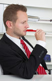 Profile of stressed business man chewing pen Stock Photo