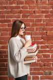 Profile of student going with books and coffee Royalty Free Stock Images