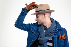 Profile of stylish attracive young man in hat and gloves Royalty Free Stock Photo