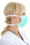 Profile of surgeon woman in mask Stock Photos