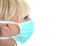Profile of surgeon woman in mask over white Stock Photo