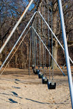 Profile of a swingset Stock Images